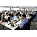 Des traders de La City à Londres ont fait bénir leur téléphone mobile